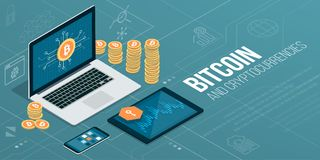 Bitcoin and cryptocurrencies. Laptop and mobile devices with financial app and piles of bitcoins Royalty Free Stock Image
