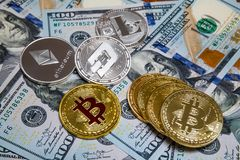 Bitcoin and cryptocurrency on banknotes of one hundred dollars. royalty free stock image