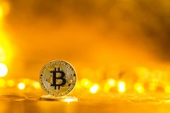 Bitcoin cryptocurrency coin. On a bright gold background Royalty Free Stock Photos