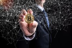 Bitcoin cryptocurrency coin with a man in a suit Stock Images