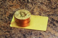 Bitcoin cryptocurrency coins with golden card Royalty Free Stock Photography
