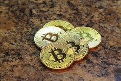 Bitcoin cryptocurrency coins  on granite table Stock Image