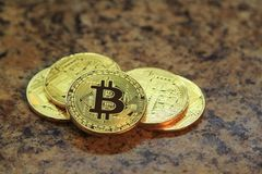 Bitcoin cryptocurrency coins isolated on granite table Royalty Free Stock Images