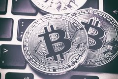 Bitcoin cryptocurrency coins on laptop keyboard. Close up toned image. Crypto currency - electronic virtual money for web banking stock photo