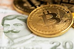 Bitcoin Cryptocurrency coins on Turkish Lira banknotes. stock image