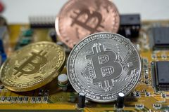 Bitcoin Cryptocurrency on computer circuit board. Macro shot.  royalty free stock photos