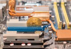 Bitcoin cryptocurrency on the computer motherboard. BTC cryptomoney.  stock image