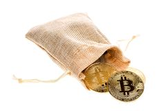 Bitcoin cryptocurrency falling out of burlap sack isolated on white background. Crypto currency electronic money for web banking a. Nd international network Royalty Free Stock Images