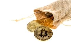 Bitcoin cryptocurrency falling out of burlap sack isolated on white background. Crypto currency electronic money for web banking a. Nd international network Royalty Free Stock Image