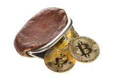 Bitcoin cryptocurrency falling out of vintage money brown purse isolated on white background. Crypto currency electronic money for. Web banking and Royalty Free Stock Photos
