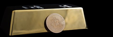 Bitcoin cryptocurrency and gold bar on a black background stock images