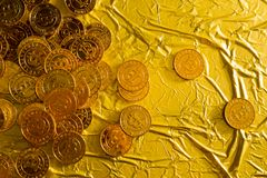 The Bitcoin cryptocurrency in gold texture image background. stock photo