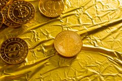 The Bitcoin cryptocurrency in gold texture image background. stock photography