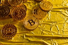 The Bitcoin cryptocurrency in gold texture image background. stock photos