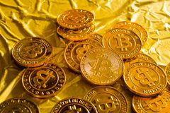 The Bitcoin cryptocurrency in gold texture image background. royalty free stock photography