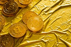 The Bitcoin cryptocurrency in gold texture image background. stock images