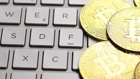 Golden bitcoin coins. Bitcoin cryptocurrency. Golden coins on laptop keyboard, macro shot with panning stock video