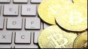 Golden bitcoin coins. Bitcoin cryptocurrency. Golden coins on laptop keyboard, macro shot with shifting focus stock video