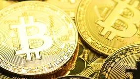 Bitcoin coins macro shot. Bitcoin cryptocurrency. Golden crypto coin, macro shot with shifting focus stock video footage
