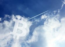 Bitcoin Cryptocurrency icon sky royalty free stock photos