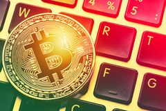 Bitcoin cryptocurrency on laptop keyboard. Close up toned image. Crypto currency - electronic virtual money for web banking and in Stock Photos