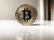 Bitcoin cryptocurrency physical coin. Bitcoin cryptocurrency concept, physical coin standing upright on table with reflection and copy space Stock Images