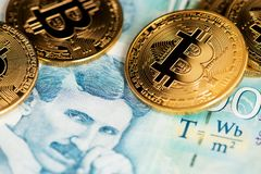 Bitcoin cryptocurrency on Serbian money Dinar banknotes close up image. Portrait of scientist Nikola Tesla. stock photos