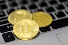 Bitcoin is a cryptocurrency and worldwide payment system. It is the first decentralized digital currency, as the system works wit. Hout a central bank or single stock image