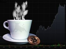Bitcoin and cup of coffee Royalty Free Stock Image