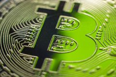 Bitcoin monet coin currency close-up. Bitcoin currency on blue glass background. Gold metal currency symbol macro photo closeup royalty free illustration