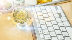 The bitcoin currency on office table for business content. Bitcoin currency on office table for business content stock images