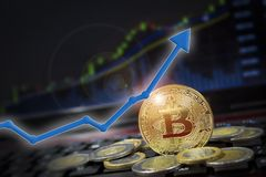 Bitcoin currency rising arrow price record highs on keyboard computer with golden bitcoin and other currencies. stock photography