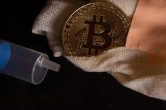 Bitcoin de la asistencia médica imagen de archivo