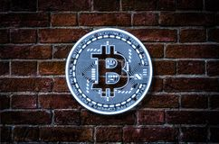 Bitcoin illustration against the brick wall stock photos