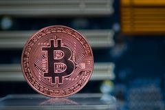 Bitcoin digital currency,  bit-coin on motherboard or electronic Royalty Free Stock Photography