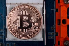 Bitcoin digital currency, bit-coin on motherboard or electronic Stock Photos