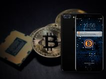 Bitcoin digital mobile online transaction Royalty Free Stock Photos