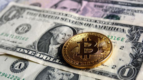 Bitcoin on  dollar banknotes. Trading concept Royalty Free Stock Photography