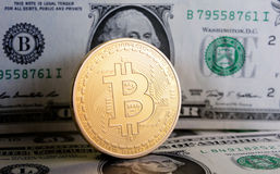 Bitcoin on dollar bill. Bitcoin on one  dollar banknote. Trading concept Stock Image