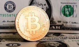 Bitcoin on dollar bill Stock Photos