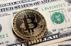 Bitcoin on dollar bill Royalty Free Stock Image
