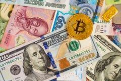 Bitcoin and dollar bills Royalty Free Stock Photo