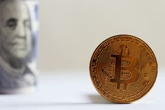 Bitcoin and dollar bills Stock Photo