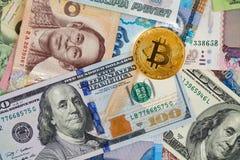 Bitcoin and dollar bills Stock Images