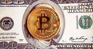 Bitcoin on dollar bills Investment, course change - concept.  royalty free stock photos