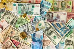 Bitcoin, dollar bills nd banknotes of other currencies of different countries Stock Photo