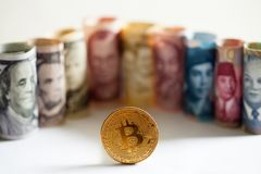 Bitcoin, dollar bills nd banknotes of other currencies of different countries Royalty Free Stock Photography