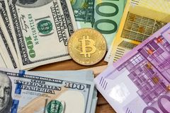 Bitcoin with dollar and euro. Banknote Stock Images