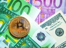 Bitcoin on dollar and euro bills investment, exchange rate, wealth, luxury, success, stock exchange - concept.  royalty free stock photos