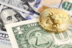 Bitcoin logo on dollars Stock Image
